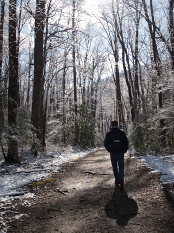 Tyler-walking-into-white-forest